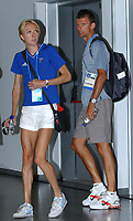 Paula Radcliffe enters her press conferance explaining her disappointment at withdrawing mid way through the marathon with husband Gary Lough. Athens Olympics, 23/08/2004. Credit: Colorsport / Matthew Impey DIGITAL FILE ONLY