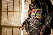 JAPAN, TOKYO Antique Kimono Oshima Tsumugi type from Amami Oshima in Okinawa. The kimono is made by woven natural brown hempy fabric, and the obi is red with embrodery flowers. Photo in a tatami room in front of the woden window - June 2014