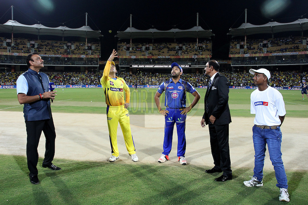 Chennai Super Kings Captain MS Dhoni tosses the coin as Mumbai Indians captain Rohit Sharma calls during match 43 of the Pepsi IPL 2015 (Indian Premier League) between The Chennai Super Kings and The Mumbai Indians held at the M. A. Chidambaram Stadium, Chennai Stadium in Chennai, India on the 8th May April 2015.<br /> <br /> Photo by:  Shaun Roy / SPORTZPICS / IPL