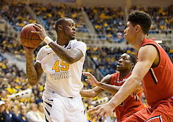 West Virginia Mountaineers forward Elijah Macon (45) looks for an open teammate against the Texas Tech Red Raiders during the first half at the WVU Coliseum.