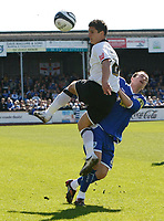 Photo: Steve Bond/Richard Lane Photography. Hereford United v Leicester City. Coca Cola League One. 11/04/2009. Kris Taylor (L) gets to the ball in front of Matt Oakley (R)