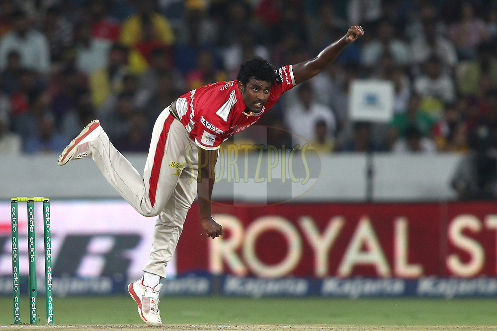 Thisara Perera of the Kings XI Punjab sends down a delivery during the second semi final match of the Oppo Champions League Twenty20 between the Kings XI Punjab and the Chennai Superkings held at the Rajiv Gandhi Cricket Stadium, Hyderabad, India on the 2nd October 2014<br /> <br /> Photo by:  Shaun Roy / Sportzpics/ CLT20<br /> <br /> <br /> Image use is subject to the terms and conditions as laid out by the BCCI/ CLT20.  The terms and conditions can be downloaded here:<br /> <br /> http://sportzpics.photoshelter.com/gallery/CLT20-Image-Terms-and-Conditions-2014/G0000IfNJn535VPU/C0000QhhKadWcjYs