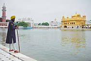 Guard men at  the Golden Temple, monitoring visitors and ensuring sacred nature of the site.