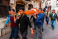 A corpse is carried to the funeral pyre to be cremated.  Pashupatinath Temple, a Hindu temple along the Bagmati River in Kathmandu, Nepal. The Bagmati is equally as sacred to Nepalese as the Ganges is to Indians. Hindus are brought to be cremated here.