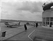"""17/05/1956<br /> 05/17/1956<br /> 17 May 1956<br /> Interior views at Dublin Airport. View of Aer Lingus DC3 """"Colmcille"""" EI-ACE and  Vickers Viscount """"Brigid"""" EI-AFW from the terminal."""