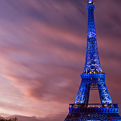 View of the Eiffel tower illuminated in blue displaying the European symbol due to the French presidency of the European Union, Paris, France, Europe