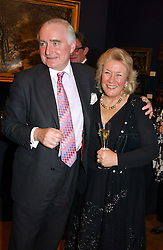 SIR TIMOTHY & LADY CLIFFORD  at a reception hosted by Brian Ivory Chairman of the Trustees of The National Galleries of Scotland to commemorate Sir Timothy Clifford's 21 years of Director of the National Gallery of Scotland and his forthcoming retirement in January 2006, held at Christie's, King Street, London W1 on 6th December 2005.<br />