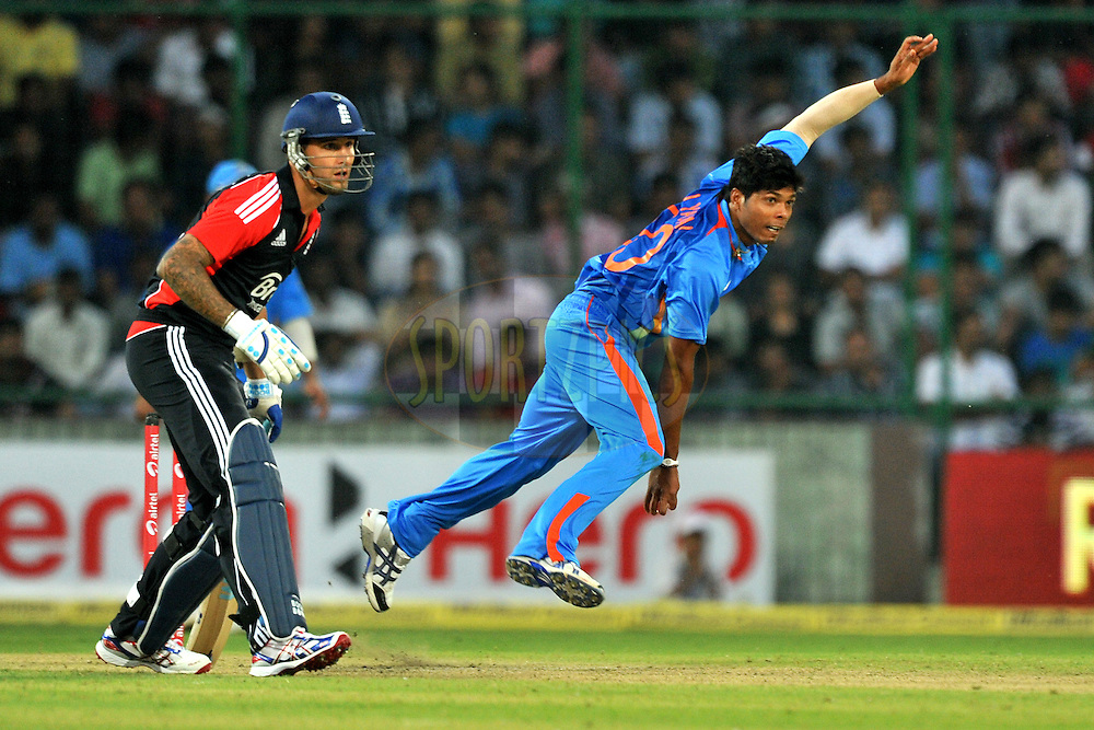 Umesh Yadav of India bowls during the 2nd One Day International ( ODI ) match between India and England held at the The Feroz Shah Kotla Stadium, Delhi on the 17th October 2011..Photo by Pal Pillai/BCCI/SPORTZPICS