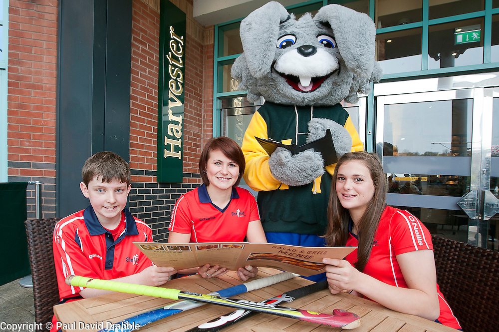 Official opening of Sheffield's new Harvester Salad & Grill at Meadowhall..Harvesters mascot  Harvey The Rabbit takes order from Sheffield Hockey club players (left to right ) Callum Grouege, Ali Crewesmith and Jemima Board. .10 November 2011. Image © Paul David Drabble