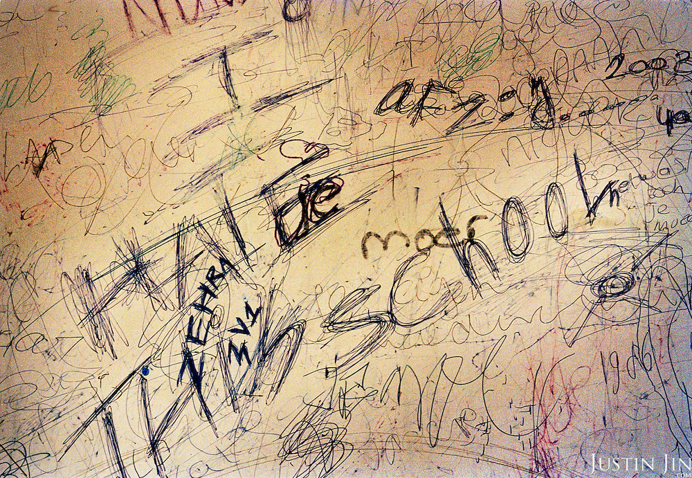 Graffiti at a vocational secondary school in east Amsterdam..The school is mostly made up of kids of Turkish and Moroccan backgrounds.  .Picture shot in Amsterdam in 2004 by Justin Jin. .