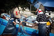 Sado island, August 20 2010 - Women in traditional Sado dress preparing the fishnets in Ogi port.