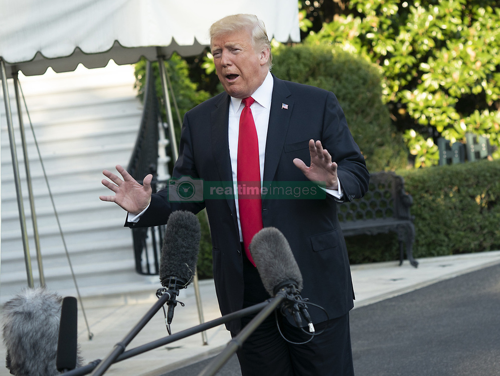 September 29, 2018 - Washington, District of Columbia, U.S. - United States President Donald J. Trump speaks to the media as he departs The White House in Washington, DC, headed to West Virginia to attend political events, September 29, 2018. Credit: Chris Kleponis / Pool via CNP (Credit Image: © Chris Kleponis/CNP via ZUMA Wire)