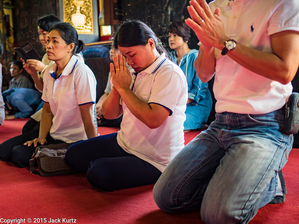 14 DECEMBER 2015 - BANGKOK, THAILAND:  People pray for the Supreme Patriarch before the start of his funeral at Wat Bowon Niwet in Bangkok. Somdet Phra Nyanasamvara, who headed Thailand's order of Buddhist monks for more than two decades and was known as the Supreme Patriarch, died Oct. 24, 2013, at a hospital in Bangkok. He was 100. He was ordained as a Buddhist monk in 1933 and appointed as the Supreme Patriarch in 1989. He was the spiritual advisor to Bhumibol Adulyadej, the King of Thailand when the King served as a monk in 1956. His funeral, which will take three days,   Dec. 15-17, will be attended by thousands of Thais and most of the Royal Family. Buddhist clergy from around the world are expected to attend.      PHOTO BY JACK KURTZ