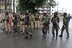 June 15, 2018 - India - Indian policemen and paramilitary soldiers stand guard after militants launched offensive against police in Srinagar. In which three civilians and two policemen were wounded, one of them critically. (Credit Image: © Umer Asif/Pacific Press via ZUMA Wire)