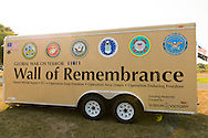 "East Meadow, New York, U.S. 11th September 2013. The Wall of Remembrance trailer is by the Global War on Terror ""Wall of Remembrance"" a traveling memorial on display in New York for the first time, at Eisenhower Park on the 12th Anniversary of the terrorist attacks of 9/11. The unique 94 feet long by 6 feet high wall has, on one side, almost 11,000 names of those lost on September 11, 2001, along with heroes and veterans who lost their lives defending freedom of Americans over past 30 years. On the wall's other side is a timeline, with photos, covering 1983 to present day."