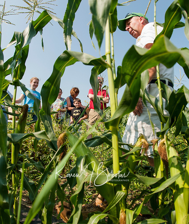 John Moulton in the corn field with the Daggett family Abby, Bridget, Judy, Jason and Jim during the Little Sprout's Garden program Wednesday morning.  (Karen Bobotas/for the Laconia Daily Sun)