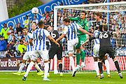 Kelle Roos of Derby County (21) punches the ball clear during the EFL Sky Bet Championship match between Huddersfield Town and Derby County at the John Smiths Stadium, Huddersfield, England on 5 August 2019.