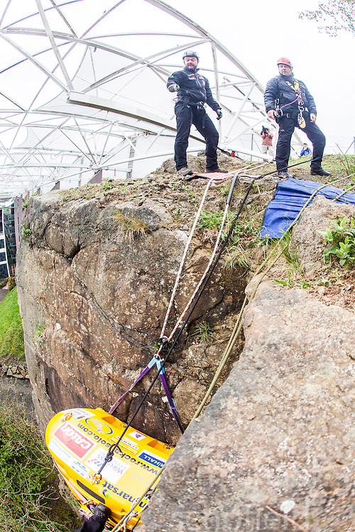 Nick Hancock (left), getting in some winch practise with his Rock Pod, at the Edinburgh International Climbing Arena, for his 60 day Rockall Solo 2014 endurance expedition. Nick will use the Rock Pod, a modified plastic water tank, to live for two months on Rockall, a uninhabited remote granite islet, hundreds of miles off Scotland in the north Atlantic, in order to raise funds for Help for Heroes.