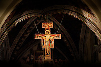 The San Damiano Cross is the large Romanesque rood cross that St. Francis of Assisi was praying before when he received the commission from the Lord to rebuild the Church. The original cross presently hangs in the Basilica of Saint Clare (Basilica di Santa Chiara) in Assisi.