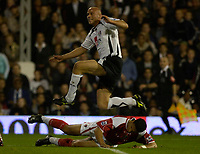 Photo: Daniel Hambury.<br />Fulham v Charlton Athletic. The Barclays Premiership. 16/10/2006.<br />Fulham's Claus Jensen watches as his shot goes in. 2-0.