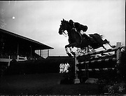 03/08/1960<br /> 08/03/1960<br /> 03 August 1960<br /> R.D.S Horse Show Dublin (Wednesday). David Broome of Great Britain clearing a pole jump on &quot;Sunsalve&quot; at the Dublin Horse Show.