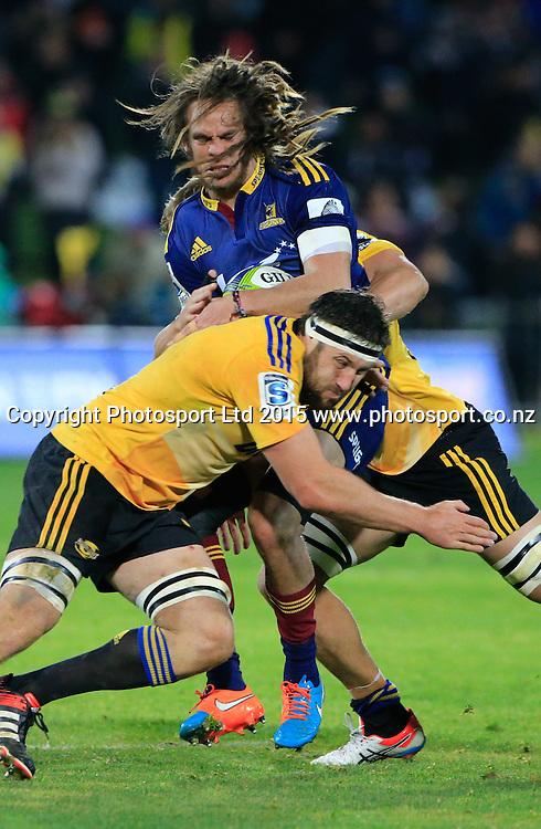 Highlander's Dan Pryor is tackled. Super 15 rugby match. Hurricanes v Highlanders, McLean Park, Napier, New Zealand. Friday, 06 June, 2015. Photo: John Cowpland / www.photosport.co.nz