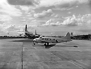 17/08/1960<br /> 08/17/1960<br /> 17 August 1960<br /> Air - Sea rescue mission from Baldonnel airstrip. Irish Aircorps de Havilland DH.104 Dove taxing for take off. Note the United States Airforce Globemaster transports in the background to transport the Irish 33rd Battalion for United Nations duty in the Congo.