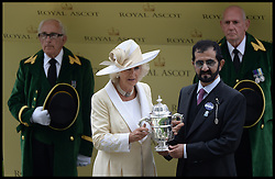 The Duchess of Cornwall presents Sheikh Mohammad Bin Rashid Al Maktoum with the St James Trophy in the Parade ring on the Opening day of Royal Ascot 2013 Ascot, United Kingdom<br /> Tuesday, 18th June 2013,<br /> Picture by Andrew Parsons / i-Images