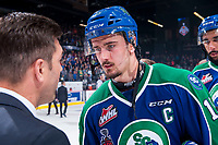 REGINA, SK - MAY 23: Glenn Gawdin #15 of the Swift Current Broncos shakes hands with Regina Pats coaching staff on his last WHL career game at the Brandt Centre on May 23, 2018 in Regina, Canada. (Photo by Marissa Baecker/CHL Images)