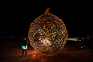"The InnerSun Project<br /> by: The InnerSun Crew<br /> from: The World<br /> year: 2019<br /> <br /> This monumental art structure is an eight-story wooden globe gently cradled by a giant pair of hands. Within, the space is lit by a sacred light: the InnerSun. A series of wheelchair accessible ramps wind up the curved walls to an equatorial terrace, where participants will gather inside the sphere.<br /> <br /> The InnerSun Project: A global art collaboration. Each massive hand on the structure is comprised of individual human-sized hands with messages from across the world written on them — our collective answer to ""what's your InnerSun?"" In this way, thousands of people from anywhere in the world can take part in the artwork itself.<br /> <br /> Many hands, one light, a better world.<br /> <br /> URL: http://www.theinnersun.org<br /> Contact: hello@theinnersun.org<br /> <br /> https://burningman.org/event/brc/2019-art-installations/?yyyy=&artType=B#a2I0V000001AXiaUAG"