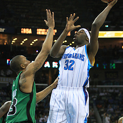 11 February 2009:  New Orleans Hornets forward Julian Wright (32) shoots over Boston Celtics guard Gabe Pruitt (13) during a 89-77 loss by the New Orleans Hornets to the Boston Celtics at the New Orleans Arena in New Orleans, LA.
