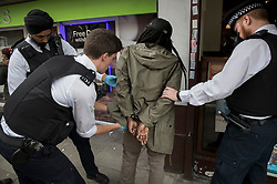 FILE IMAGE © Licensed to London News Pictures. 25/05/2018. London, UK. Police detain and search a man who is later arrested on suspicion of breaching a court order - during a gang patrol in Islington. Photo credit: Peter Macdiarmid