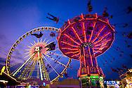 Europe, Germany, North Rhine-Westphalia, Ruhr area, Herne, the kermis in the district Crange [the kermis in Crange is the biggest fair in North Rhine-Westphalia] ferris wheel Bellevue and chairoplane.....Europa, Deutschland, Nordrhein-Westfalen, Ruhrgebiet, Herne, die Cranger Kirmes im Stadtteil Crange [die Cranger Kirmes ist das groesste Volksfest in Nordrhein-Westfalen] das Riesenrad Bellevue und ein Kettenkarussell.....[For each usage of my images the General Terms and Conditions are mandatory.]