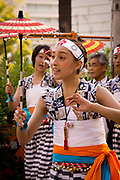 A young lady dancing in the Tenjin Festival (Tenjin Matsuri) in Osaka.