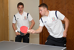 CARDIFF, WALES - Tuesday, September 4, 2012: Wales' Joe Allen and Chris Gunter during a players' table tennis tournament at the St. David's Hotel ahead of the Brazil 2014 FIFA World Cup Qualifying Group A match against Belgium. (Pic by David Rawcliffe/Propaganda)