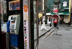 IRELAND DUBLIN 6FEB06 - Payphones in Dublin's trendy Temple Bar district. . jre/Photo by Jiri Rezac. . © Jiri Rezac 2006. . Contact: +44 (0) 7050 110 417. Mobile:  +44 (0) 7801 337 683. Office:  +44 (0) 20 8968 9635. . Email:   jiri@jirirezac.com. Web:    www.jirirezac.com. . © All images Jiri Rezac 2006 - All rights reserved.