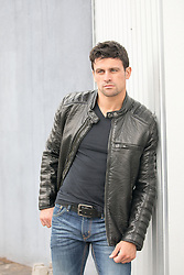 hot guy in a tee shirt and leather jacket