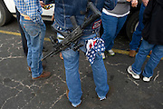 Johnny Shaver carries his riffle and American flag handkerchief during an open carry long rifle march demonstrating their 2nd amendment right to keep and bear arms on Thursday, January 31, 2013 in Fort Worth, Texas. (Cooper Neill/The Dallas Morning News)
