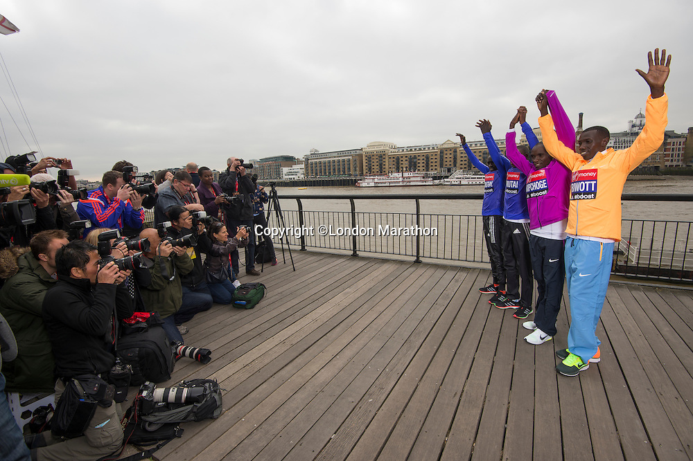 Virgin Money London Marathon 2015<br /> <br /> Photographers at the Press conference featuring some of the the leading contenders for the London Marathon.<br /> <br /> Left to Right<br /> Emmanuel Mutai  Kenya<br /> Geoffrey Mutai  Kenya<br /> Eliud Kipchoge  Kenya<br /> Stanley Biwott  Kenya<br /> <br /> Photo: Bob Martin for Virgin Money London Marathon<br /> <br /> This photograph is supplied free to use by London Marathon/Virgin Money.