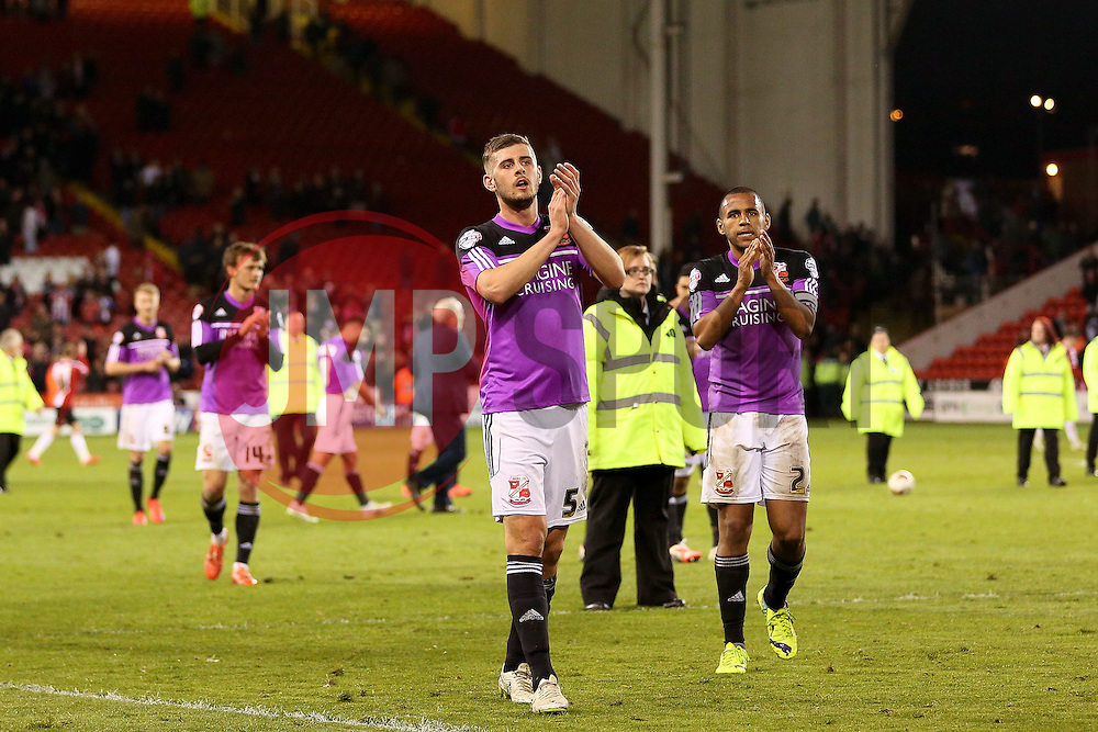 Swindon Town players celebrate after the final whistle - Photo mandatory by-line: Matt McNulty/JMP - Mobile: 07966 386802 - 07/05/2015 - SPORT - Football - Sheffield - Bramall Lane - Sheffield United v Swindon Town - Sky Bet League One
