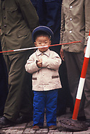 A small boy watches as President Reagan reviews the troops  at a ceremony during the visit of President Ronald Reagan to China  in April 1984.<br /> Photo by Dennis Brack