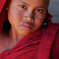 A portrait of a young novice monk in a village near Mandalay, Myanmar.