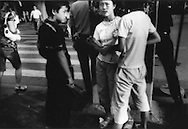 Adult faces on street kids peddling roses on Shanghai street, China.