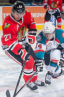 KELOWNA, CANADA - APRIL 25: Rourke Chartier #14 of the Kelowna Rockets stick checks Oliver Bjorkstrand #27 of the Portland Winterhawks on April 25, 2014 during Game 5 of the third round of WHL Playoffs at Prospera Place in Kelowna, British Columbia, Canada. The Portland Winterhawks won 7 - 3 and took the Western Conference Championship for the fourth year in a row earning them a place in the WHL final.  (Photo by Marissa Baecker/Getty Images)  *** Local Caption *** Rourke Chartier; Oliver Bjorkstrand;