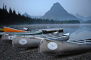 Canoes on the bank of Two Medicine Lake, Glacier National Park, Montana