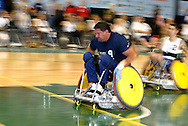 July 7th, 2006: Anchorage, AK - Scot Severn (9) speeds in for a score as White defeated Blue in the gold medal game of Quad Rugby at the 26th National Veterans Wheelchair Games.