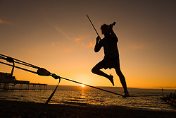 September 1, 2017 - Aberystwyth, Wales, UK - Aberystwyth, Wales, UK. 21 year old postgraduate student ALEX FREEMAN, takes a break from his physics master's degree studies to play the violin and balance on slack-lines as the sun sets over Cardigan Bay on Aberystwyth, at the end of a bright and sunny first day of September  (Credit Image: © Keith Morris/London News Pictures via ZUMA Wire)