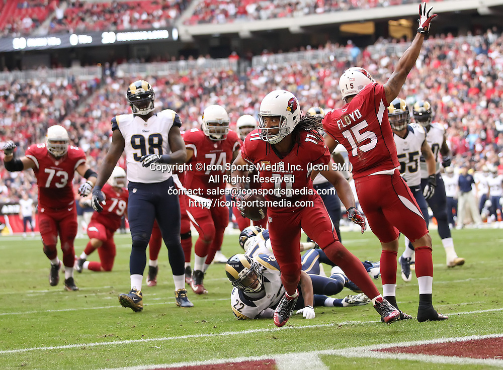 Dec 8 2013: Cardinals Larry Fitzgerald (11) runs in for a TD during the Arizona Cardinals hosting the St. Louis Rams game in the University of Phoenix Stadium in Glendale, AZ.  The Cardinals defeat the Rams 30-10.