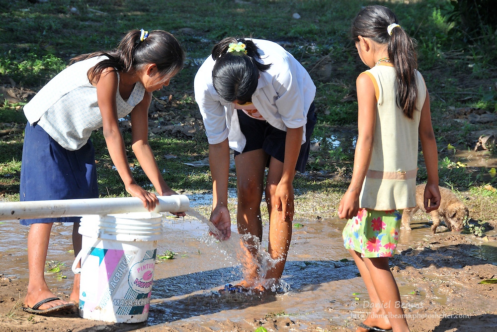 Yuracare children playing in clean water in Villa Hermosa, near San Lorenzo, Beni, Bolivia
