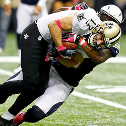 October 7, 2012; New Orleans, LA, USA; San Diego Chargers linebacker Demorrio Williams (58) tackles New Orleans Saints wide receiver Greg Camarillo (17) during the second half of a game at the Mercedes-Benz Superdome. Mandatory Credit: Derick E. Hingle-US PRESSWIRE